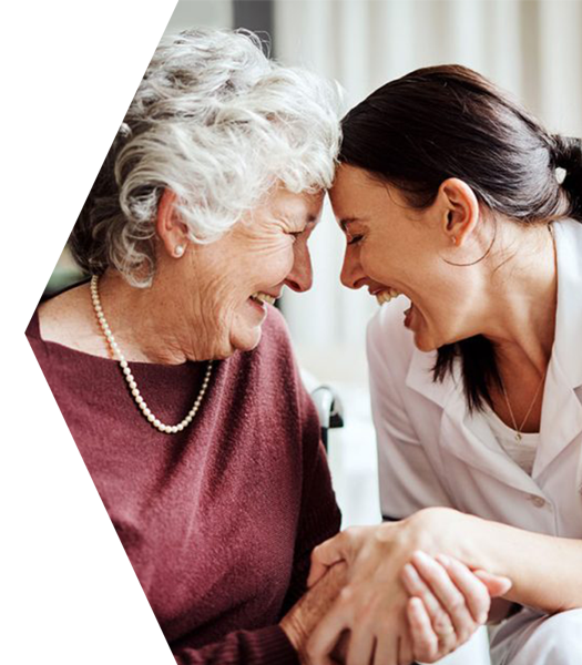 Senior Woman and Nurses Aide